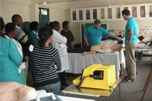 GECS Team teaching defibrillation skills.